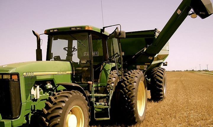 Front View Of Tractor Attached to a Grain Auger